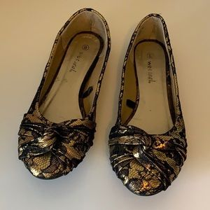 Gold and black metallic ballet flats